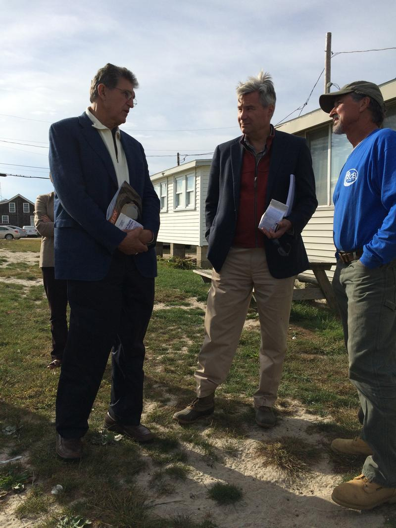 Sen. Joe Manchin (D-WV) and Sen. Whitehouse (D-RI) visit with Matunuck resident Kevin McCloskey, whose front row beach cottage at Roy Carpenter's Beach will need to be moved to the back row before next summer.