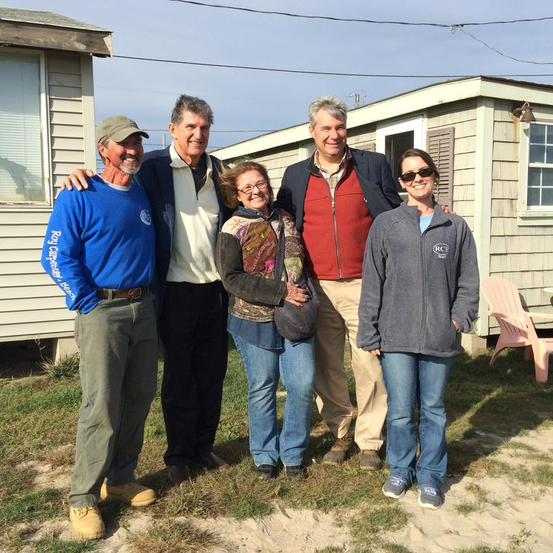 Matunuck residents Kevin McCloskey, Nancy Thoresen (middle), and Christa Thoresen share a photo opp with Sen. Joe Manchin (D-WV) and Sen. Sheldon Whitehouse (D-RI).