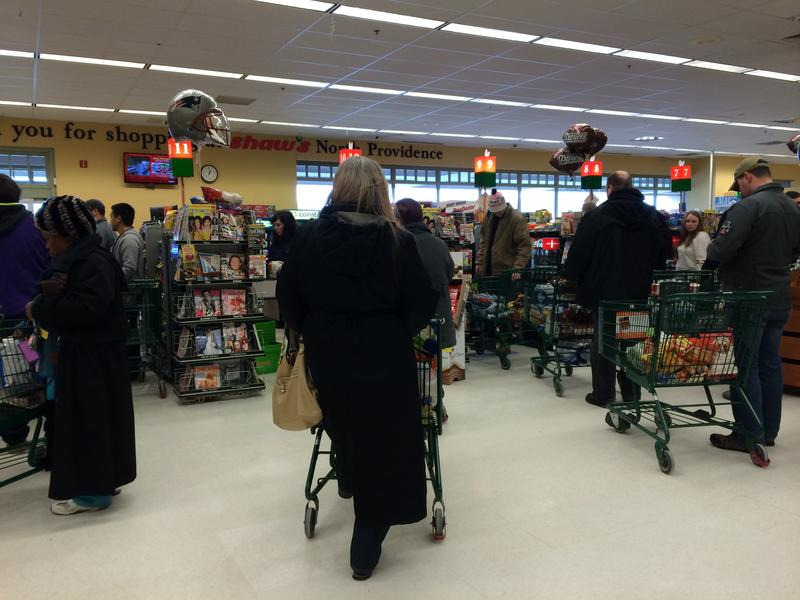 Residents line up at the Shaw's Monday afternoon in North Providence.