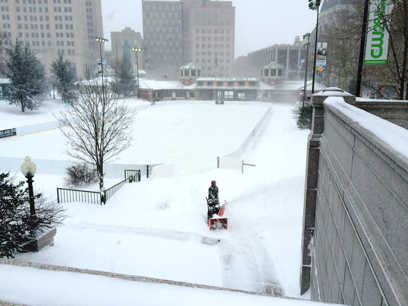 A lone snow blower clears snow from the ice skating rink in downtown Providence Tuesday morning around 9:30.