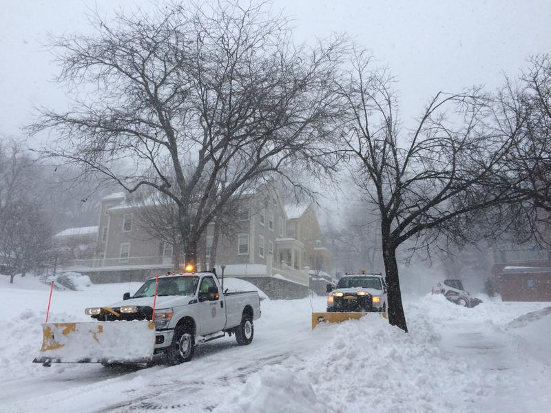 Crews plow streets on College Hill Tuesday morning in Providence