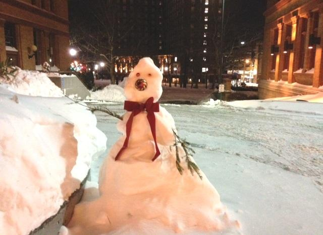 A small snowman stands in downtown Providence in the very early hours of Wednesday.