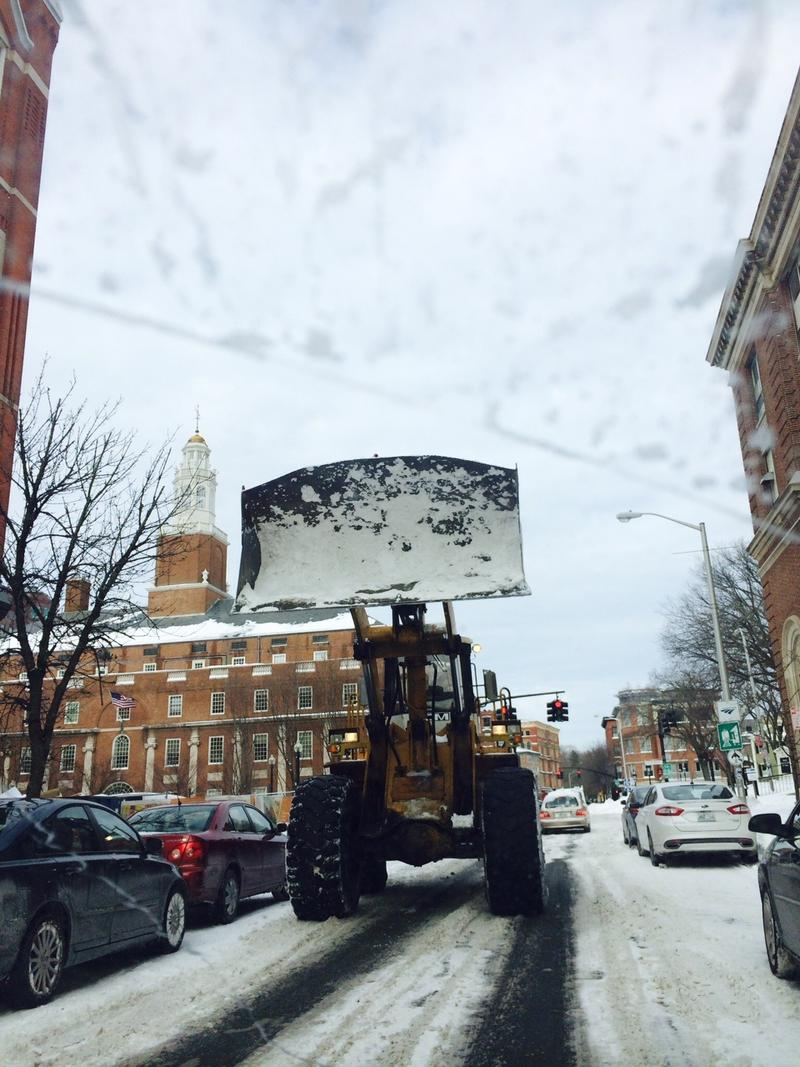Plows clearing roads in downtown Providence Wednesday morning.