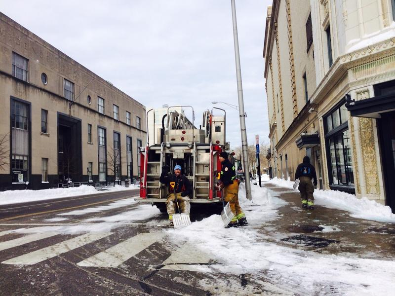 Members of the Providence Fire Department dig out hydrants in downtown Providence Wednesday