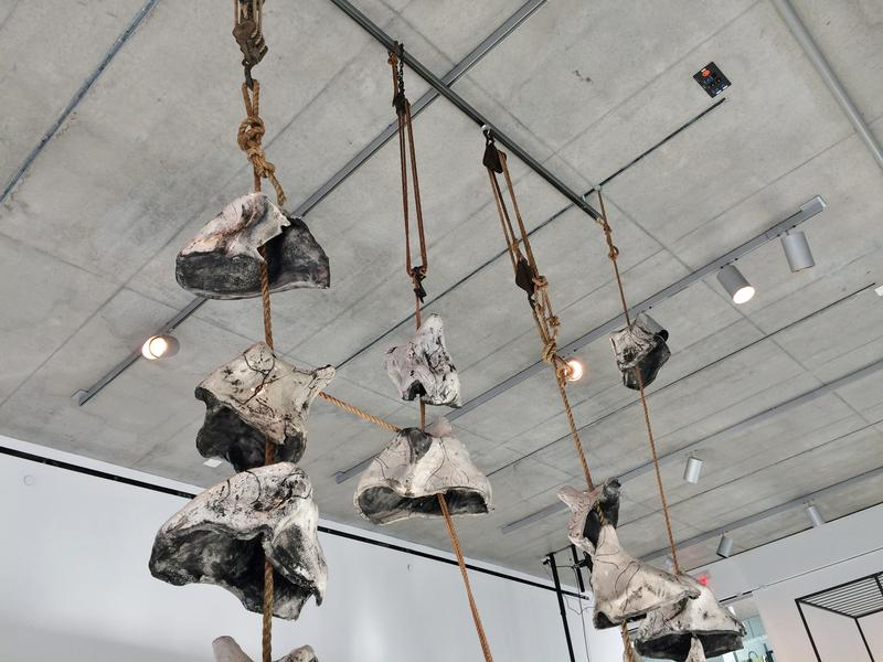 Peter Snyder's rope, pulley, and ceramic piece evokes the collapse of memory circuits in the brain.