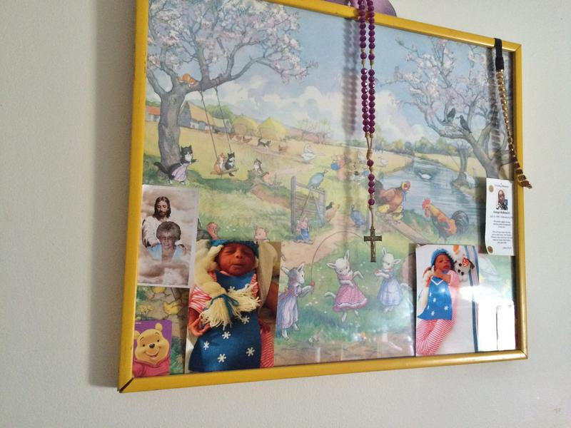 Pictures of Dalton's first client's baby, who was born premature, tucked into a pastoral scene on the bedroom wall.
