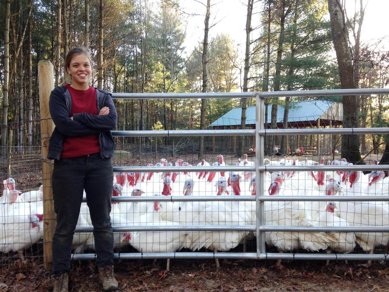 URI senior Lauren Breene stands in front of her family's turkeys at their West Greenwich farm.