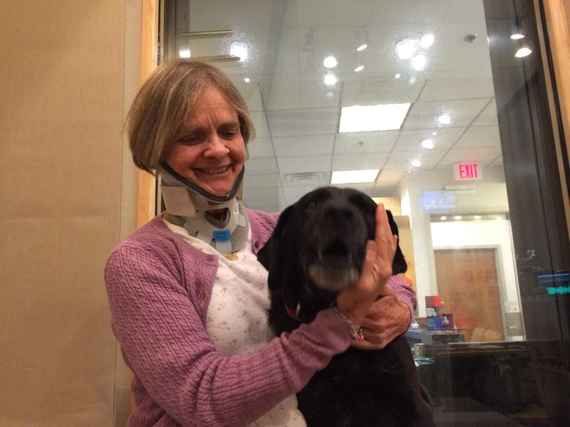 Ellen Lenox Smith cuddles her assistance dog, Maggie.