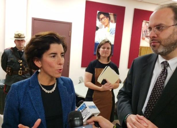 Governor Gina Raimondo standing with Commerce Secretary Stefan Pryor
