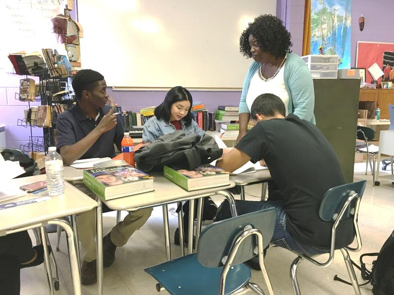 Deloris Grant speaks with her students during her college-level literature class at Central Falls High School.