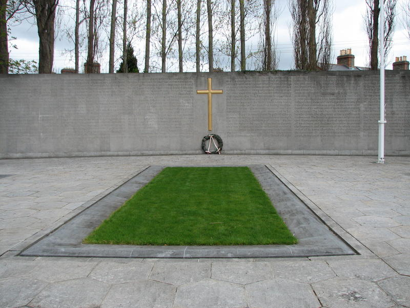 The Leaders of the 1916 Easter Rising were buried in the old prison yard of Arbour Hill prison. The memorial, designed by G. McNicholl, features the Proclamation of 1916, inscribed on the wall in both Gaelic and English.