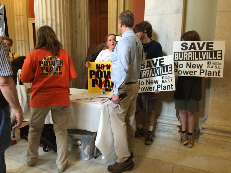 Opponents of the proposed power plant in Burrillville distributed information on steps people can take to oppose the project.