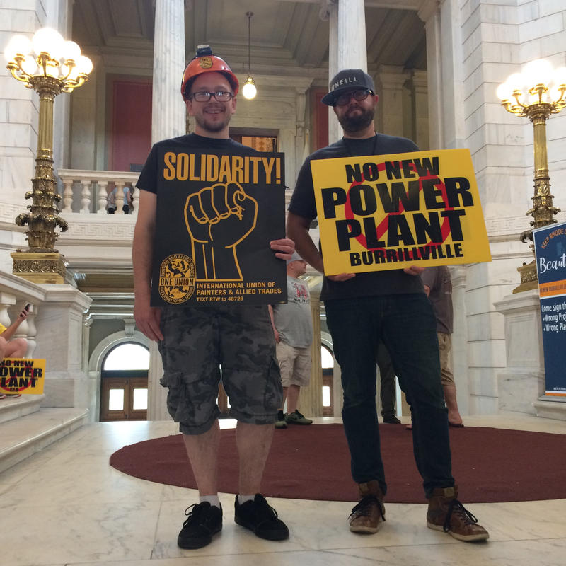 Two gentlemen with different positions on a proposed power plant in Burrillville stood side by side at the Statehouse rotunda after a rally in opposition to the project took place there before a house committee hearing on a bill related to the project.