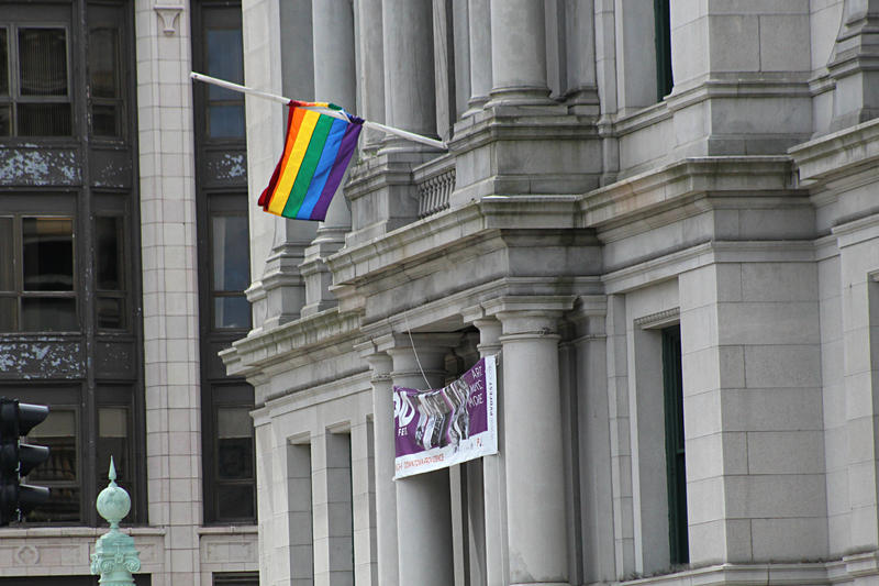 A gay pride flag hangs at half-staff on Providence City Hall