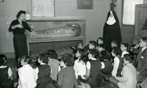 Pearl Nathan, circa 1962, with students and RISD's mummy