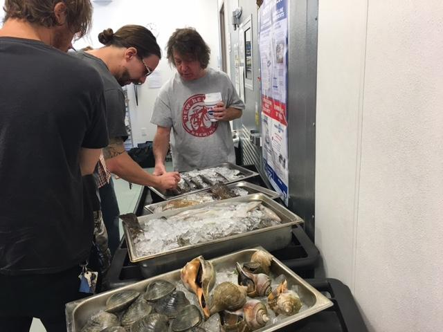 Chefs examine what's on offer, all of it caught within the last 24 hours in Rhode Island waters.