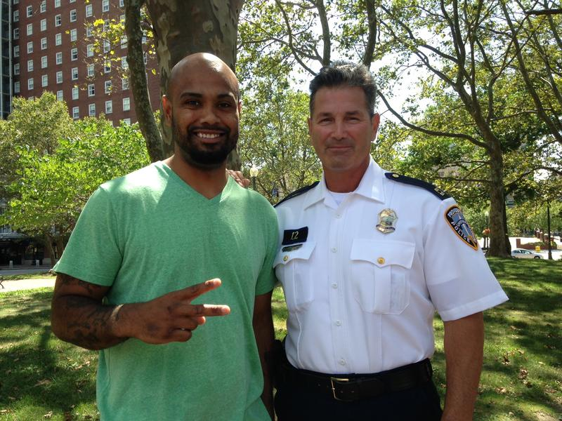 Jose Rodriguez (L) stands with Providence Police Officer Dean Isabella
