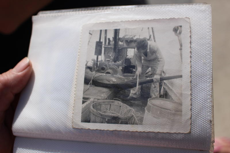 "Sykes keeps a photo album of his family fishing on the Virginia Marise. In this photo, a swordfish is so big it went across the deck. ""That's back when the swordfish used to be local,"" said Sykes."