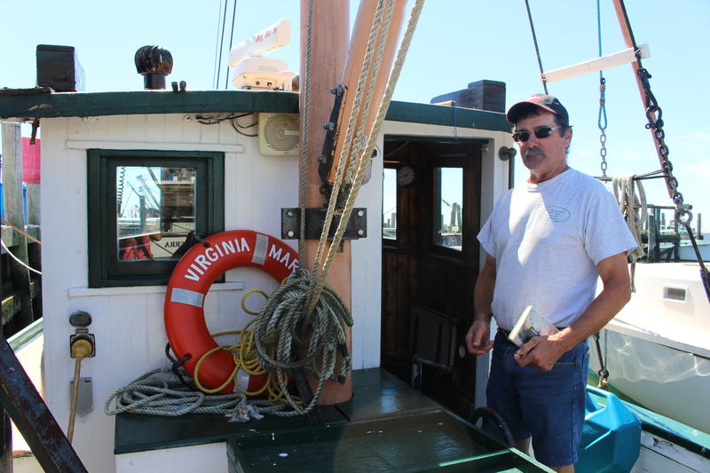 Captain Rodman Sykes with his fishing vessel Virginia Marise, the oldest working fishing vessel in Point Judith. His family had it custom-built in the early 1930s.