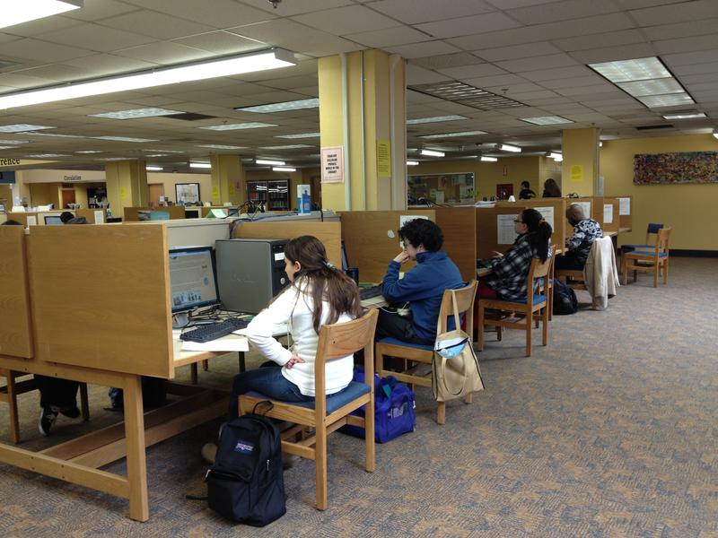 Students work at computers in the library at Rhode Island College, where tuition is slated to increase by $570 per year.