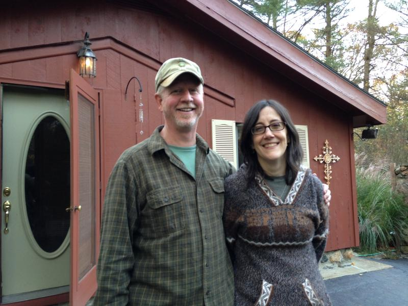 Walter Rowe and Dawn Casey-Rowe in front of their home in North Scituate Rhode Island.
