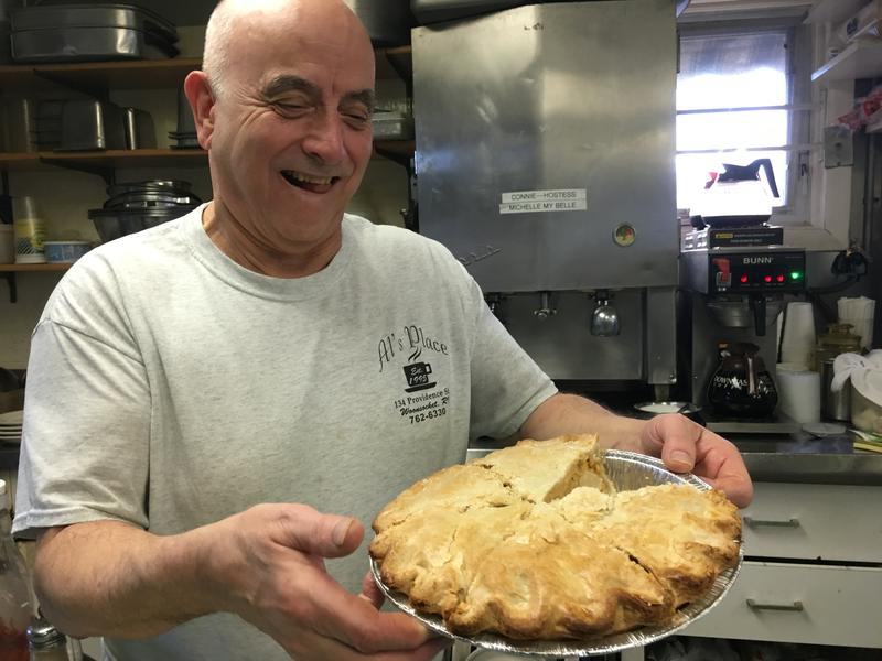 Al Bernier, owner of Al's Place in Woonsocket, holding up one of his hand made pies.