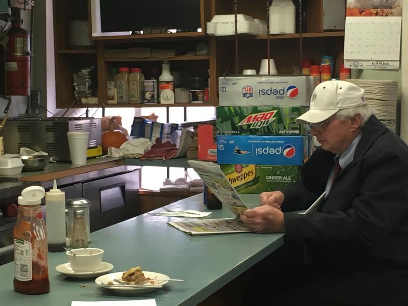 A regular customer enjoys a quiet lunch at Al's Place.