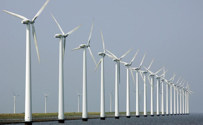 Wind turbines stand clustered offshore in Dronten, the Netherlands.