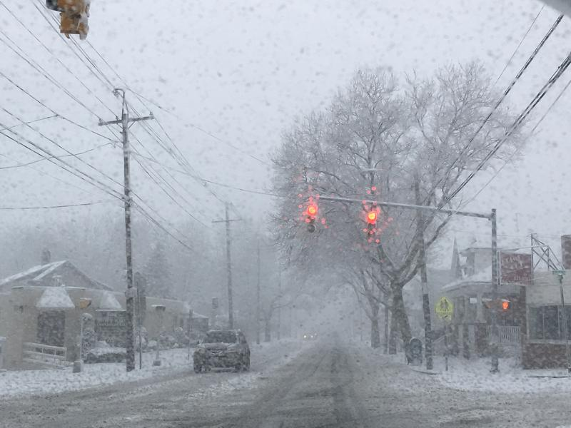 Low visibility and snowy roads just before noon in Providence's Elmhurst neighborhood.