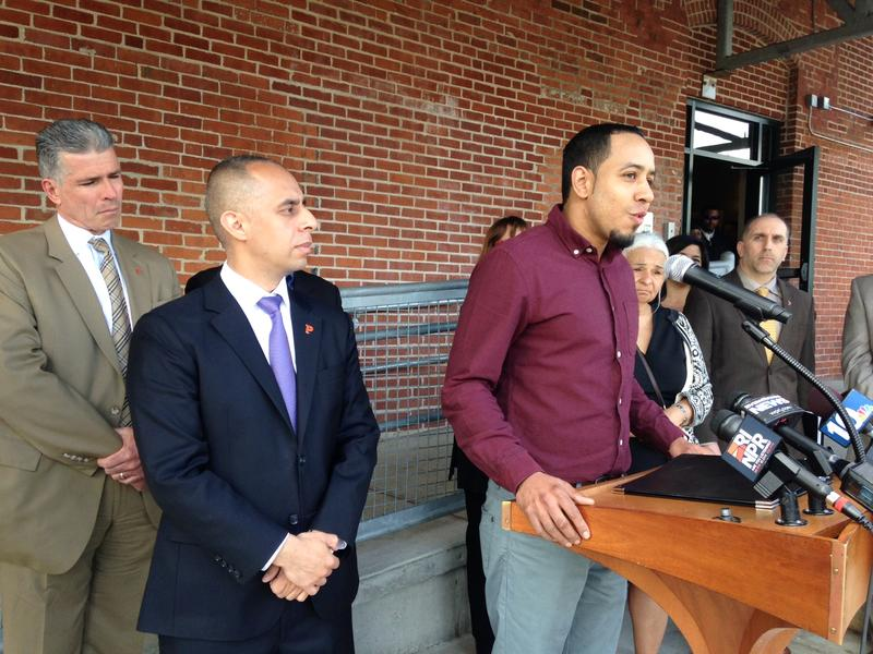(Left to right) Providence Public Safety Commissioner Steven Pare, Providence Mayor Jorge Elorza, and Angel Turbides, speak during the launch of the Rhodes to Employment program. Turbides completed a similar training program in the state.
