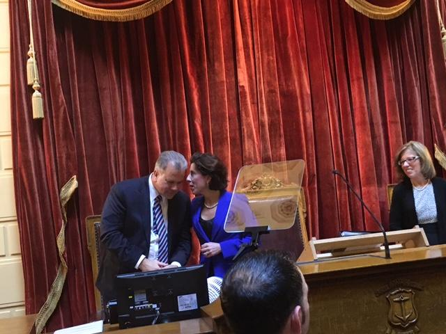 Raimondo talks with House Speaker Nicholas Mattiello during her State of the State address. They each have clashing priorities for the fiscal year beginning July 1.