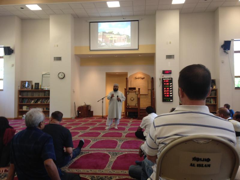Mufti Ikram, the Imam of Masjid Al-Islam, speaks to a crowd during an open Mosque event