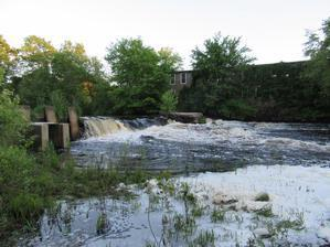 Water rushes over the Bradford Dam in the Pawcatuck River.