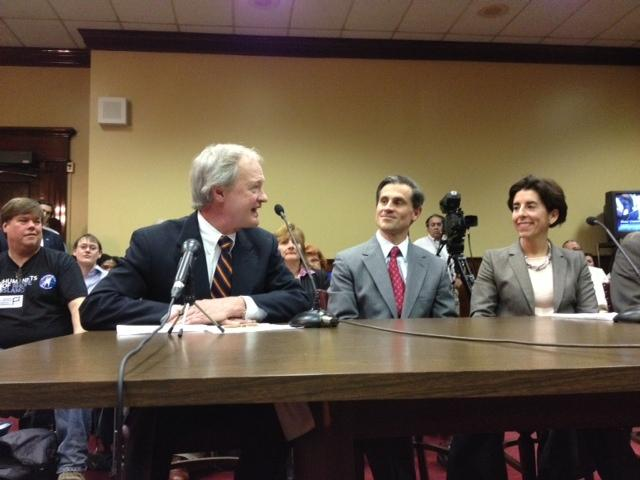 Lincoln Chafee with Gina Raimondo and her husband, Andy Moffit, in 2013