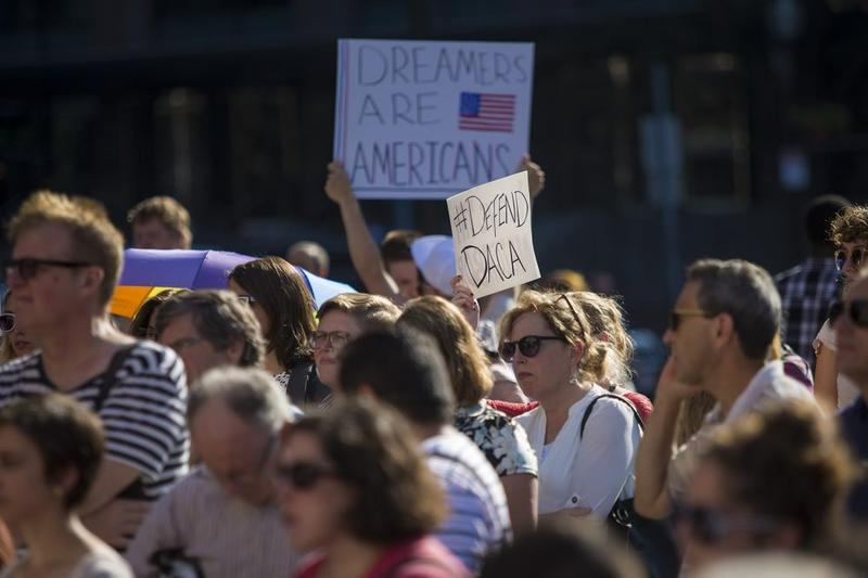 People gathered at Faneuil Hall in Boston Tuesday to protest the Trump administration's decision to end the Deferred Action for Childhood Arrivals program.