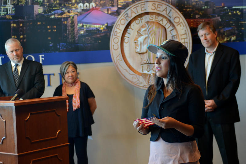 Tania Santiago, Miss Hispanic Seafair and a University of Washington student, speaks on immigration reform during Seattle Mayor Mike McGinn's news conference on DACA in July, 2013.