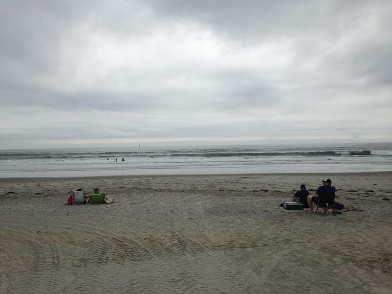 Several people watch surfers at Narragansett beach as Hurricane Jose moved north. Surfers say recent storms have brought some of the best surfing this season.