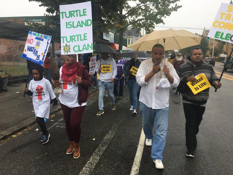 Darlene Monroe (second from left), tribal elder and march organizer, leads the protest down Broad Street in Providence.
