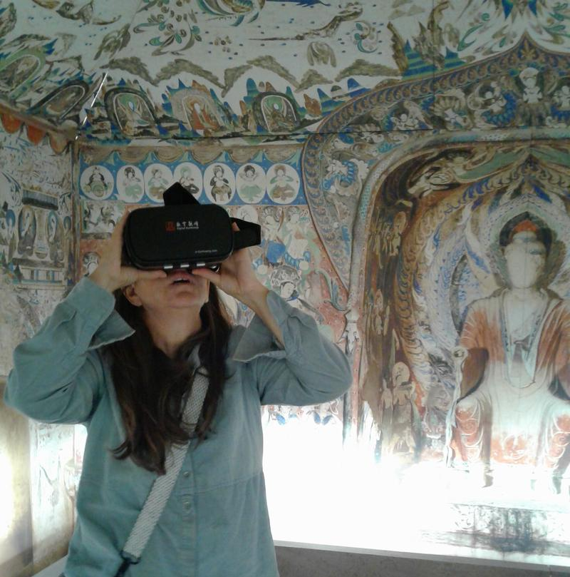 Jennifer Tierney of East Providence takes a trip to one of the Magao Caves with the help of virtual reality.