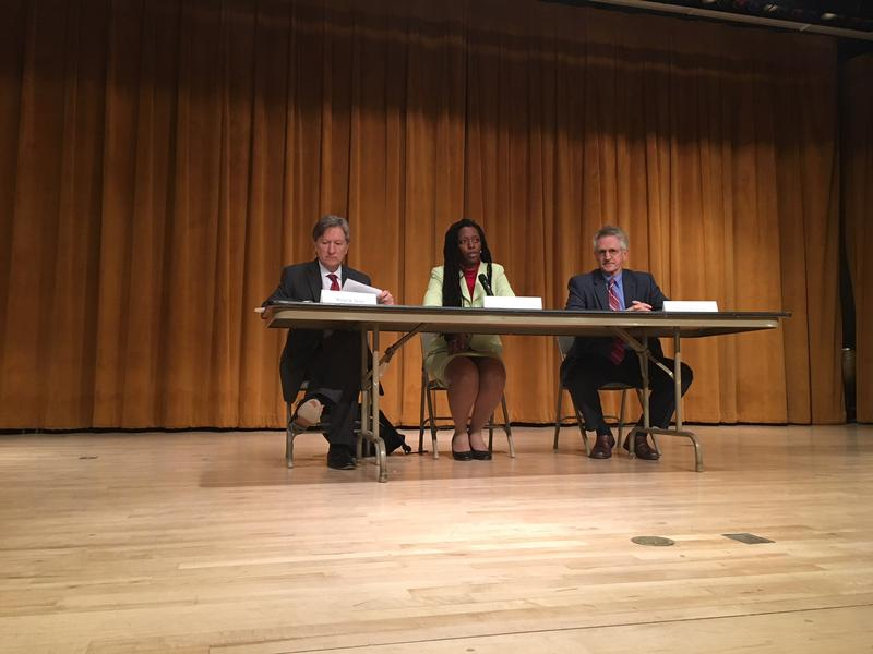 RI Health Director Nicole Alexander-Scott (center) with health department's Michael Dexter (left) and Stephen Morris (right)