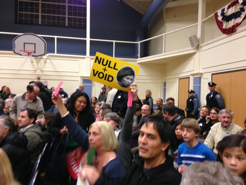 Hundreds gathered at an East Greenwich community center to protest the planned reinstatement of Town Manage Gayle Corrigan.