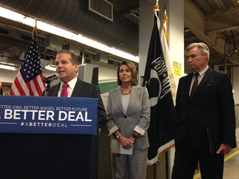 U.S. Representative David Cicilline speaks at CCRI Monday, as House Minority Leader Nancy Pelosi and Senator Sheldon Whitehouse look on.