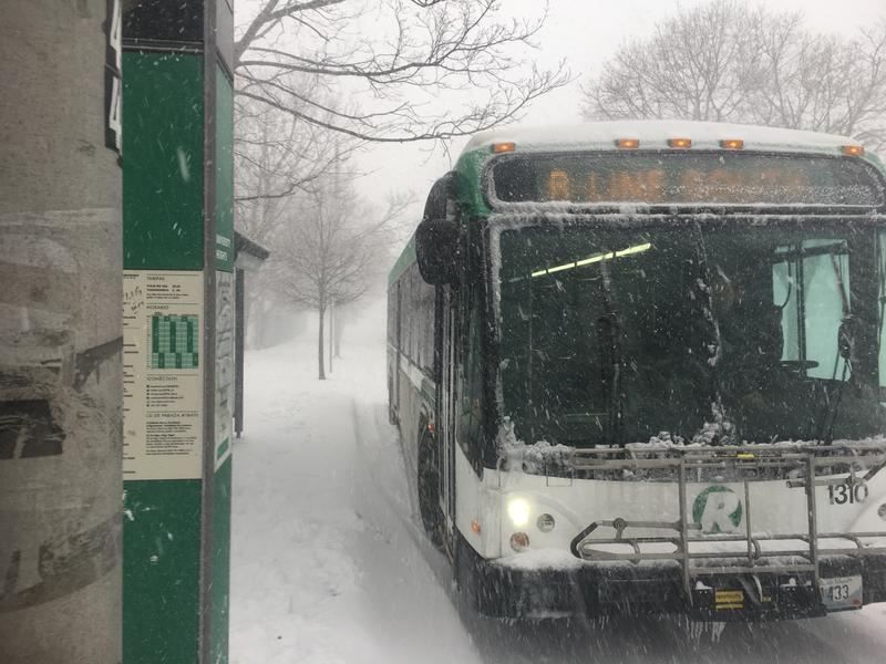 RIPTA R-Line bus makes a stop in Providence during today's snow storm.