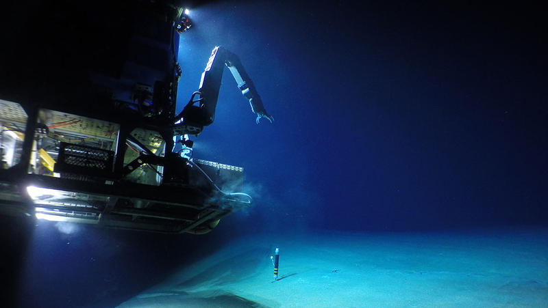 The Woods Hole Oceanographic Institution's remotely operated vehicle, Jason, lands on the seafloor at Havre submarine volcano to retrieve a heat flow monitor. Jason was used toexplore, map, and collect erupted materials from the Havre volcano in 2015.
