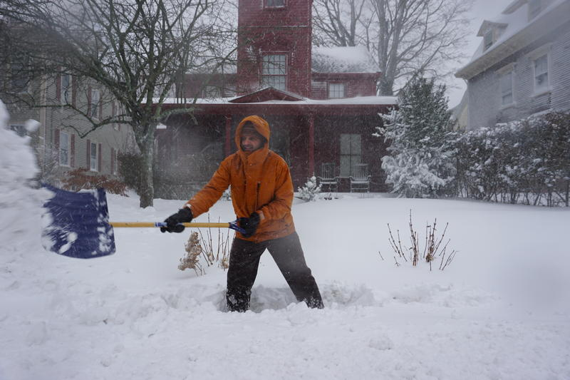 Gus Steppen shoveled out his steps and front walk even as snow continued to fall in Newport.