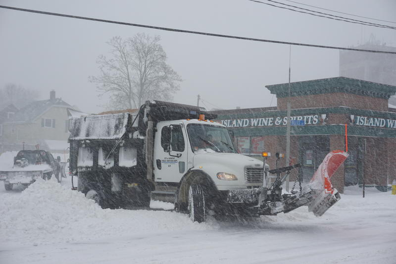 A snow plow clearing roads in Newport.