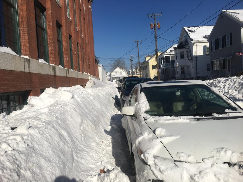 In Pawtucket, some 16 inches of snow piled up on crowded streets.