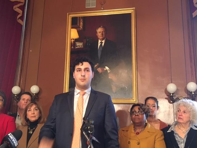 Regunberg with legislative colleagues during a news conference last year.