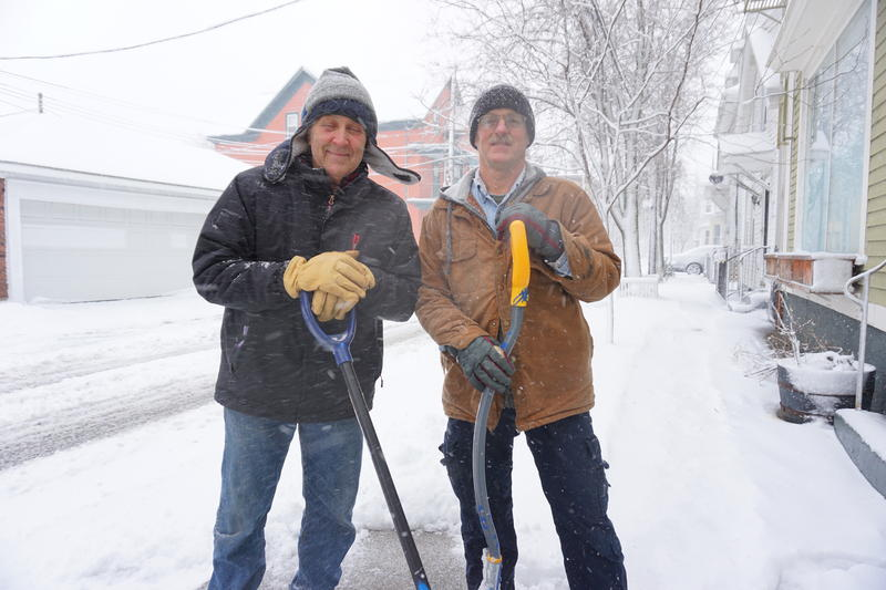 Ed Barbehenn (right) and Bill DiBello work for a property management company clearing snow off sidewalks.
