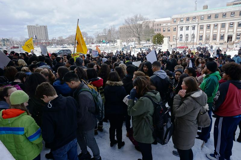 Students protesting in front of the RI Statehouse, demanding gun control legislation from lawmakers.